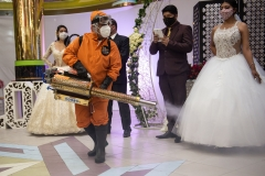 La Paz, Bolivia. 7th Oct 2020. City officials and event organizers participate in a wedding rehearsal intended to establish and show possible safety protocols. One of the proposed measures is the fumigation of the halls. Radoslaw Czajkowski