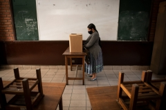 La Paz, Bolivia. 9th Oct 2020. A woman participating in a voting simulation fills out a ballot in a school room. The election is to be held on 18th Oct 2020, almost exactly one year after the last controversial one that led to a severe political crisis in Bolivia and to the forced resignation of former president Evo Morales. Credit: Radoslaw Czajkowski