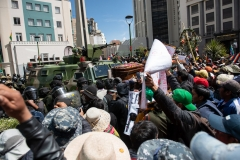 La Paz, Bolivia. 21st Nov 2019. Protesters confronting the security forces deposited a coffin containing the remains of a person shot on November 19th on an APC. The military and Police were guarding the access to the main square of the city, where the protesters intended to deposit the coffins originally. Radoslaw Czajkowski/ Alamy Live News