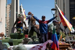 La Paz, Bolivia. 21st Nov 2019. Protesters deposited a coffin containing the remains of a person shot on November 19th on an APC and then climbed the vehicle. The military and Police were guarding the access to the main square of the city, where the protesters intended to deposit the coffins originally. Radoslaw Czajkowski/ Alamy Live News