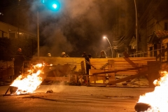 La Paz, Bolivia. 11th Nov 2019. Neighbors all over La Paz raised barricades after groups of alleged Evo Morales supporters attacked different neighborhoods the night before, burning down houses of prominent opposition leaders and destroying over 60 buses of the public transportation. Radoslaw Czajkowski/ Alamy Live News