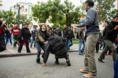 La Paz, Bolivia. 13th Nov 2019. In an attempt to calm down the situation, a protester tries to help up a Police officer. He has been pushed to the ground by another participant of a demonstration against the burning of the Wiphala flag by the Police, an important indiginous symbol and since 2009 the second official flag of Bolivia. Radoslaw Czajkowski/ Alamy Live News