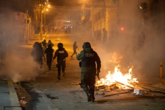 La Paz, Bolivia. 7th Nov 2019. The Police defended together with government supporters the access to the main square of La Paz, Plaza Murillo. Opposition supporters used fireworks and dynamite, but had to withdraw after the heavy use of tear gas by the Bolivian riot Police (UTOP). Fires were lit by the protesters to reduce the effects of the tear gas. Radoslaw Czajkowski/ Alamy Live News