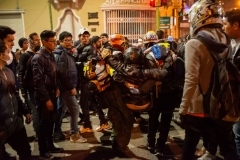 La Paz, Bolivia. 6th Nov 2019. A protester injured by dynamite thrown by miners supporting Evo Morales is being carried to an ambulance.  Radoslaw Czajkowski/ Alamy Live News