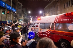 La Paz, Bolivia. 6th Nov 2019. An ambulance leaves with a protester injured by dynamite thrown by miners supporting Evo Morales.  Radoslaw Czajkowski/ Alamy Live News